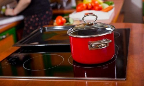 Red Pot With Lid On Cooktop Induction Pros