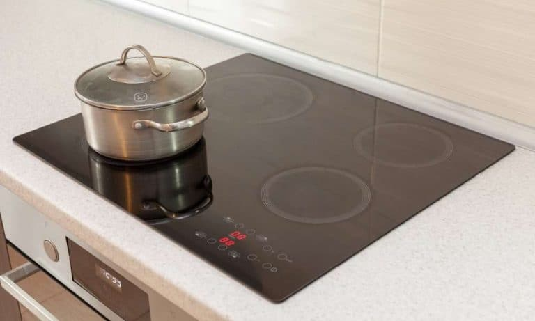 stainless steel pot with lid on cooktop