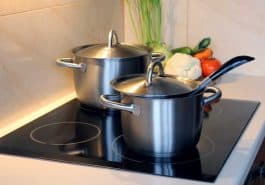 stainless steel pots on four burner built-in induction cooktop