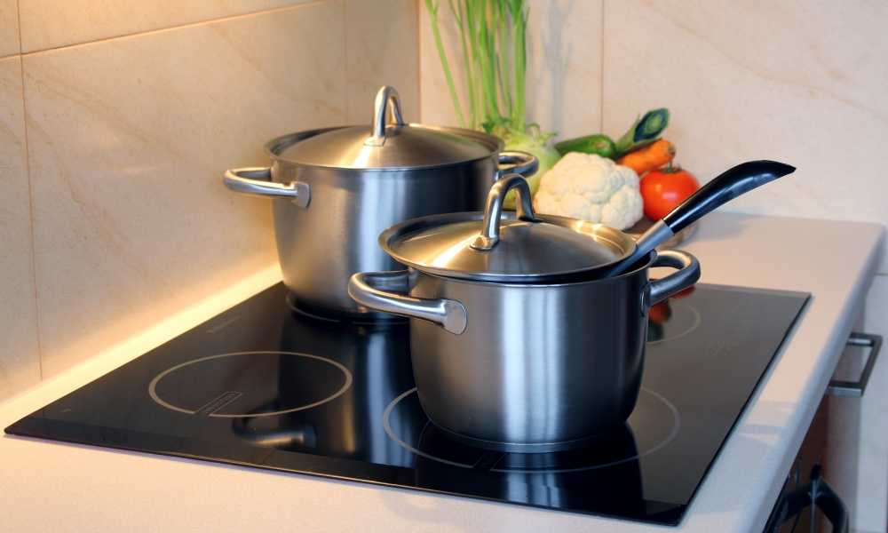 Stainless Steel Pots On Four Burner Built In Induction Cooktop