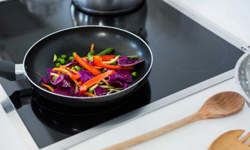 stir fry in induction frying pan on built-in induction cooktop