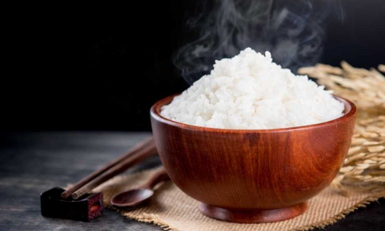 white rice in brown wooden bowl