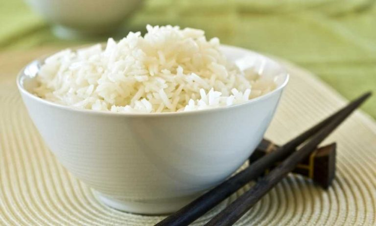 white rice in bowl with chopsticks