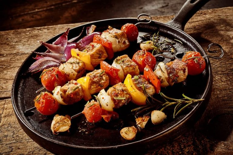 cast iron griddle with kebabs