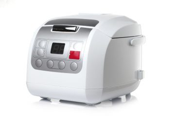 white digital rice cooker in white background