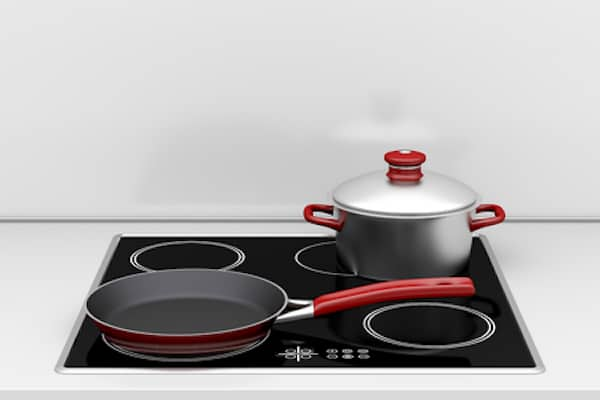 pot and frying pan on induction stove