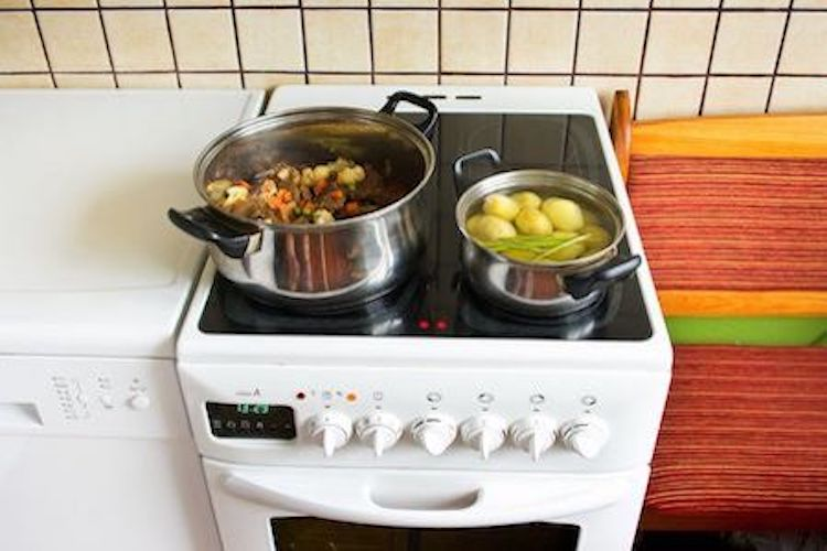 food being prepared on electric cooker