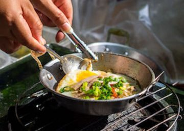 Chef cooking Thai food in frying pan
