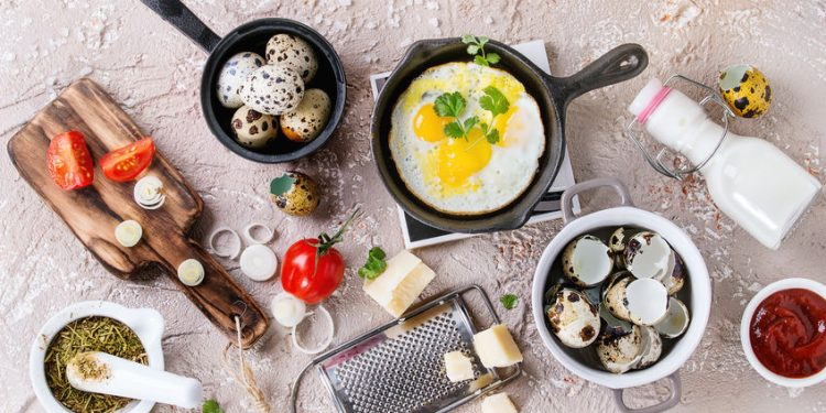 cast iron skillet with fried quail eggs