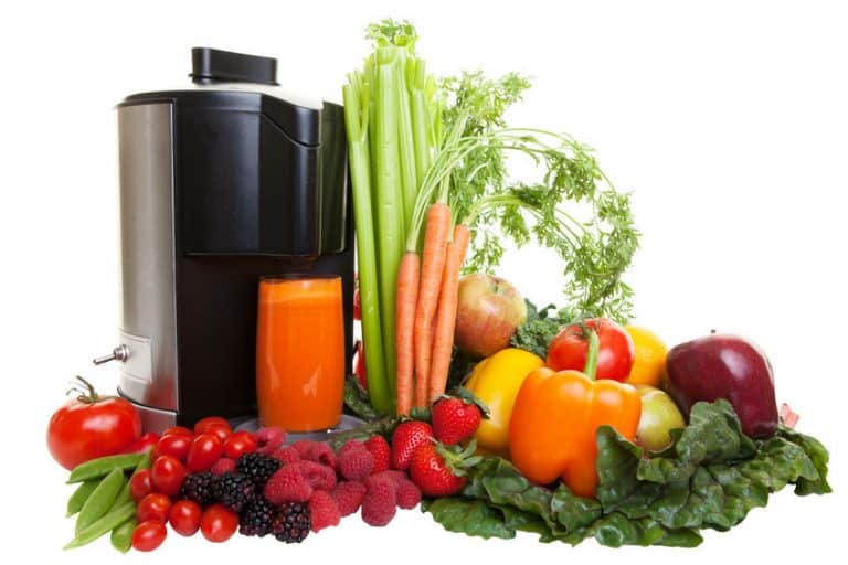 A Juicer surrounded by fruits and vegetables