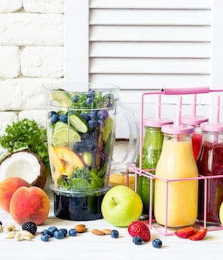 Healthy smoothies in a bottles and fresh ingredients.