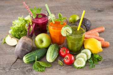 fresh vegetables and juice on wooden table