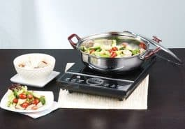 pot with vegetables on induction cooktop