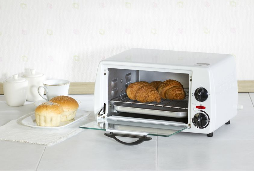 Toaster oven with croissants.