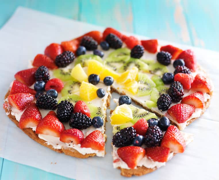 fruit pizza with berries kiwi and pineapple cream cheese on crust