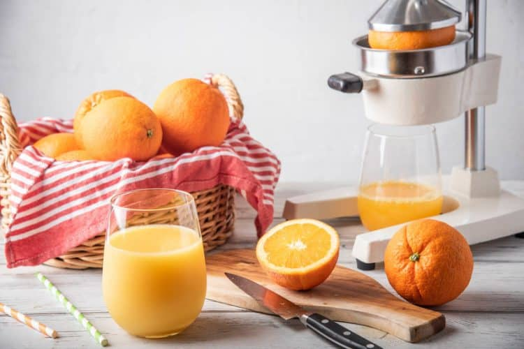 citrus juicer with fresh squeezed orange juice