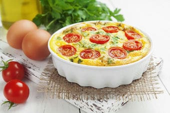 Frittata in ceramic dish with ingredients