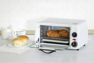 toaster oven with croissants on rack