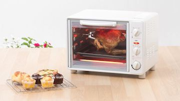 toaster oven with whole chicken on rotisserie