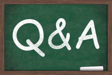 Q&A written on a chalkboard with a piece of white chalk