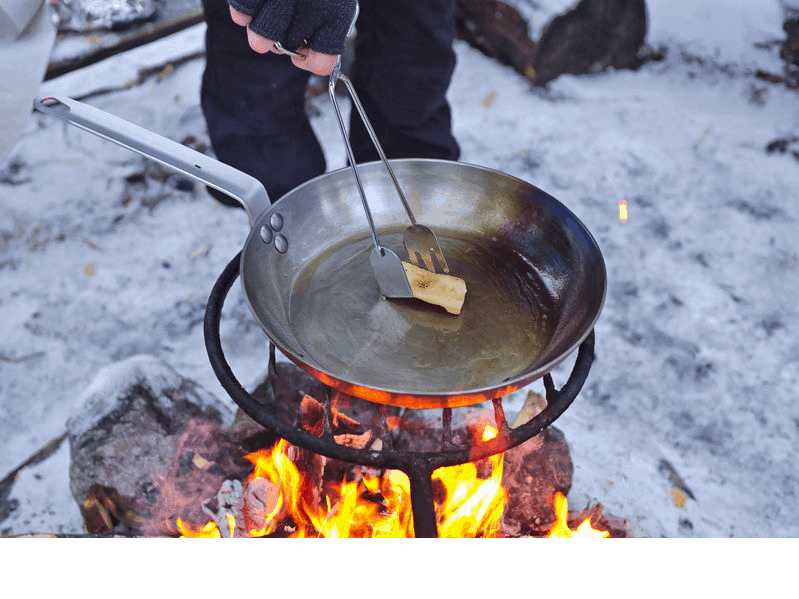 carbon steel pan over fire grill