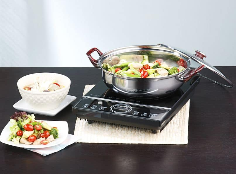 pot with food cooking on induction cooktop