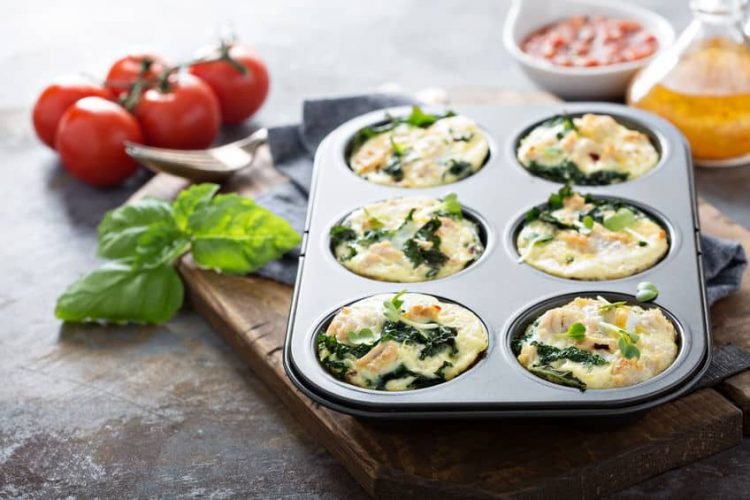 High protein egg muffins with kale and ground turkey in a muffin tin