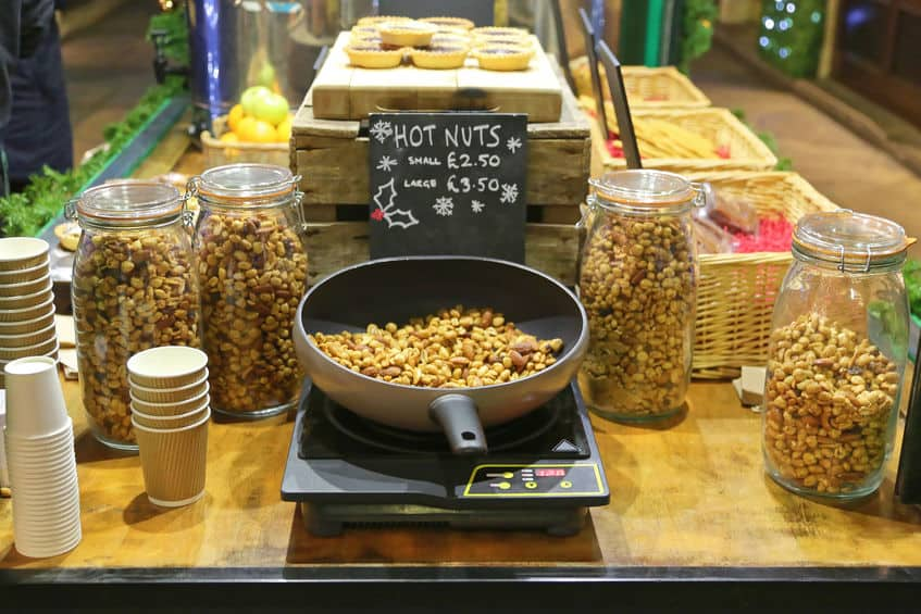 hot peanuts and cashews on induction cooktop in store