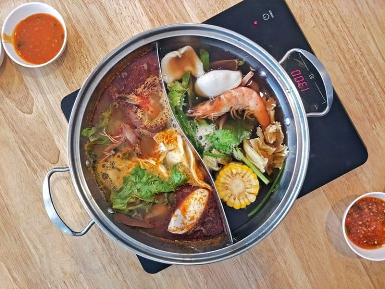 using induction cooktop to cook japanese hot pot shabu with double side pot