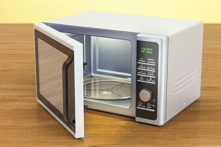 Microwave on the wooden table.
