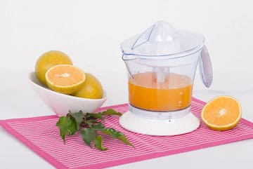 citrus juice extractor with oranges and fresh juice