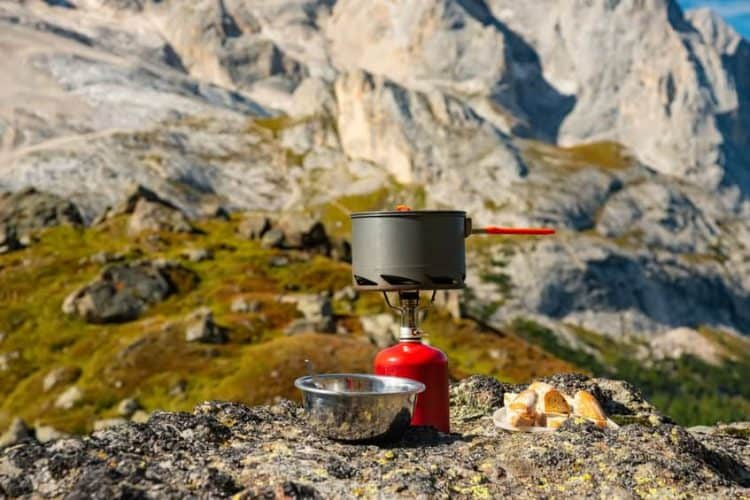 backpacking stove and pot in mountains