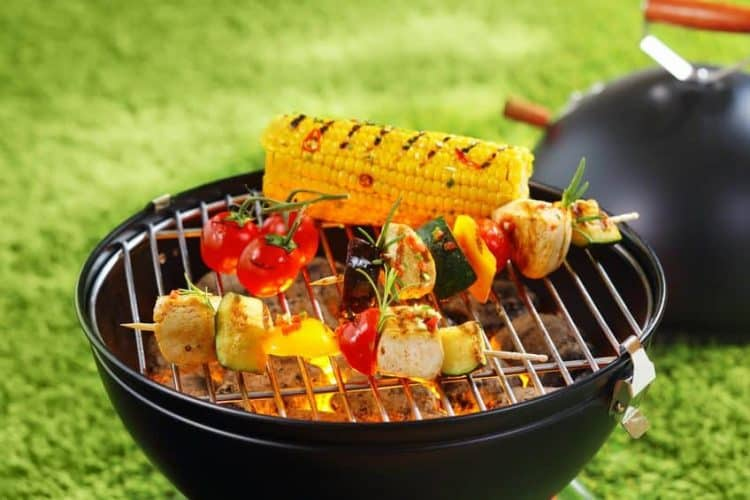 corn on the cob and vegetables on grill