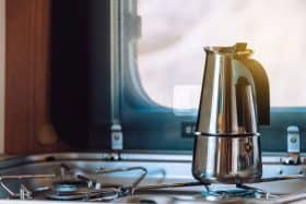 camping stove in camper kitchen with coffee maker