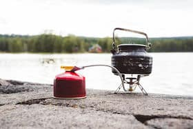 remote canister with compact backpacking stove