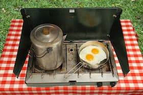 propane camping stove, eggs frying and coffee pot