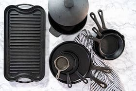 Cast iron frying pans, pot, and griddle
