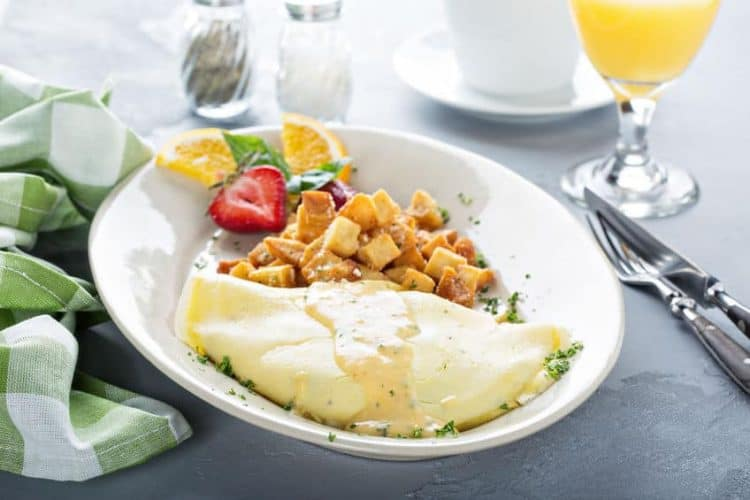 Crab omelette with potatoes on a white plate for breakfast