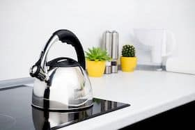 Stainless Steel kettle in modern kitchen with induction stove